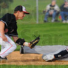 Tribune-Star/Jim Avelis<br /> No ball: Brave shortstop Michael Daugherty applies the tag to Patriot baserunner Micahel Mace while the ball skips past his glove. Mace was called out on the play.
