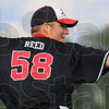 Tribune-Star/Jim Avelis<br /> Shutout: A.J. Reed pitched a shutout against cross-town rival Terre Haute North Friday on the Braves' diamond.