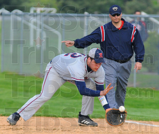 Tribune-Star/Jim Avelis<br /> Fair ball: Patriot first baseman David Knight fields a ground ball for an out.