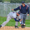 Tribune-Star/Jim Avelis<br /> Fair ball: Patriot first baseman David Knight fields a ground ball for an out.