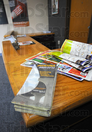 Tribune-Star/Jim Avelis<br /> Outdated: Two year old maps and travel brochures lay jumbled on the counter top in the visitors center at the Clear Creek rest stop.