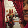Tribune-Star/Rachel Keyes<br /> Peeking in: Brenda Ryherd (right) peeks in on Terre Haute South senior Colleen Bray(right) as she tries on her prom dress one more time before it goes to the back to be tailored.