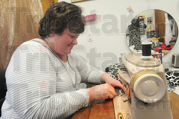 Tribune-Star/Rachel Keyes<br /> Making changes: Beth Nairn makes alterations on a prom dress.