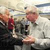 Tribune-Star/Rachel Keyes<br /> Rubbing elbows: Senator Richard Lugar shakes hands with Jack Knust at the Clay County YMCA. The Senator was invited to speak on behalf of the Clay County Republican Club.