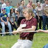 Tug time: Group leader Kelly Blackburn of Angola, Indiana gets into the action as she participates in a tug-o-war contest during Friday's Ag Expo.