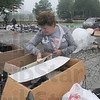 Tribune-Star/Rachel Keyes<br /> Helping hope: Jo Moreland looks through items at the House of Hope yard sale that will continue through next week. Proceeds go towards the maintenance of the House of Hope.