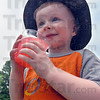 Tribune-Star/Jim Avelis<br /> Another satisfied customer: Duncan Cole Rose takes his first taste of Kool-Aid at Jaden Maresch's stand along Poplar Street Wednesday afternoon.