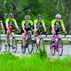 Riders: Jerry Harnack leads fellow riders Joe Van Denburg, Andy Boneff, Chad Smith and Todd Harver down US 40 across the Wabash River Bridge Monday evening.