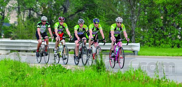 Riders: Jerry Harnack leads fellow riders Joe Van Denburg, Andy Boneff, Chad Smith and Todd Harver down US 40 across the Wabash River Bridge Monday evening.