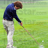 Tribune-Star/Jim Avelis<br /> Wet start: Heavy overnight rains added to the difficulty of the Hulman Links golf course for participants in the Metropolitan Interscholastic Conference golf championships Saturday. Here Sam Pollock hits from a sodden fairway.