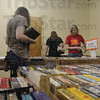 Tribune-Star/Rachel Keyes<br /> Searching for fiction: Kelly Macshane (left) Ruth Roberts (middle) and Chelsea Armacost search through the mystery section at the annual Friends of the Library book sale.