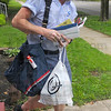 Tribune-Star/Jim Avelis<br /> One at a time: Letter carrier Gary McGaha carries bags of food he collected along his South 7th street route Saturday. He gave a rough estimate that about one in five homes along his route had filled a bag with food.
