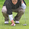 Tribune-Star/Jim Avelis<br /> Line it up: Terre Haute North golfer Will Pollock line up a putt on the #2 green.