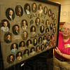 Tribune-Star/Jim Avelis<br /> Popular item: Class photos are one of the more numerous items that have found their way to the Education Heritge Museum. Here Pat Breault holds the collage from the 1931 Valley High graduation calss.