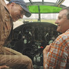Tribune-Star/Rachel Keyes<br /> A quick lesson: Pilot Jordan Brown (left) gives Jerry Laue a quick lesson in flying in the cockpit of the B-25J Bomber.