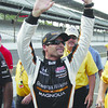 Alex Tagliani, of Canada, waves after winning the pole on the final qualification attempt on the opening day of time trials for the Indianapolis 500 auto race at Indianapolis Motor Speedway in Indianapolis, Saturday, May 21, 2011. (AP Photo/Tom Strattman)
