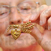 Tribune-Star/Jim Avelis<br /> Involvement: Pins designating club involvement and class rings are some of the smaller items that the Education Heritage Museum has colllected.
