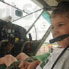 Tribune-Star/Rachel Keyes<br /> Ready for lift off: Six-year-old Robbie Burkel sits at the controls of a passenger plane at the Hulman Airport Open House Saturday morning.