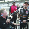 Alex Tagliani, of Canada, celebrates with car owner Sam Schmidt after winning the pole on the opening day of qualifications for the Indianapolis 500 auto race at Indianapolis Motor Speedway in Indianapolis, Saturday, May 21, 2011. (AP Photo/Tom Strattman)