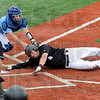 Safe: Southern's #4, Jordan Sivertsen scores past the attempted tag of Indiana State University catcher Adam Richart during Saturday's game.