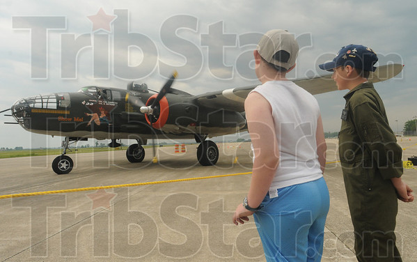 Tribune-Star/Rachel Keyes<br /> Watching dad: Ten-year-olds Hunter Vincent and best friend Jordan Ray Brown watch as Jordan's father and great-grandfather take off in B-24J Bomber at the Hulman Airport Open House Saturday morning.