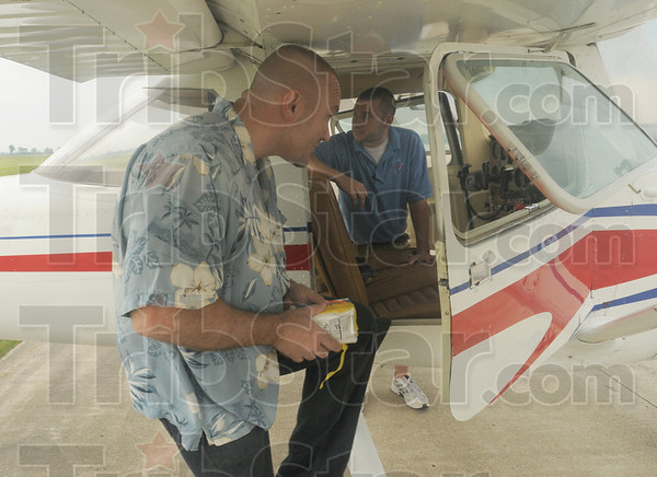 Tribune-Star/Rachel Keyes<br /> Bombs away: Tribune-Star reporter Brian Boyce prepares to board a plane to participate in the Bomb Drop for Cancer to benefit the Tyler Genneken Foundation.