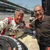 Tribune-Star/Rachel Keyes<br /> Taking time: Mario Andretti (left) takes a minute to pose with fan Joe Claretto at the Indy Race Experience.
