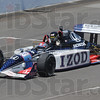 Tribune-Star/Rachel Keyes<br /> Living a dream: Joe Claretto waves as he zips by in the IZOD car at the Indy Race Experience.