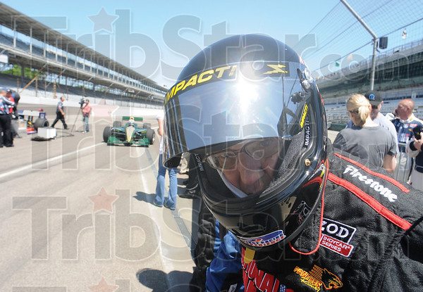 Tribune-Star/Rachel Keyes<br /> Ready to go: Joe Claretto stands in line waiting to take his ride around the track with Mario Andretti.