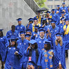 Tribune-Star/Jim Avelis<br /> Filing in: Graduates walk down the ramp into Hulman Center for their Commencement  Saturday.