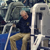 Tribune-Star/Jim Avelis<br /> New limits: Granville Lowe resets the resistance on one of the weight machines before working his arms.