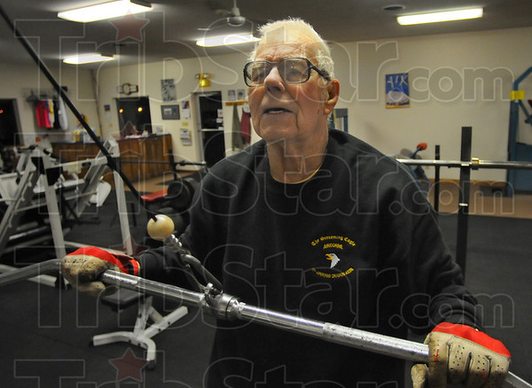 Tribune-Star/Jim Avelis<br /> Getting started: Granville Lowe warms up early in his daily routine of resistance  and aerobic exercise.