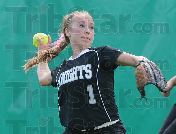 Tribune-Star/Rachel Keyes<br /> Stop: Northview's Nicole Nelson prepares to throw to the cut off man after making  a stop in action against Terre Haute South Saturday.