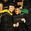 Tribune-Star/Rachel Keyes<br /> A step forward: April Baranowksi (left) receives her diploma from St. Mary of the Woods President Dottie L. King (right) she graduated with a Bachelor of Science.