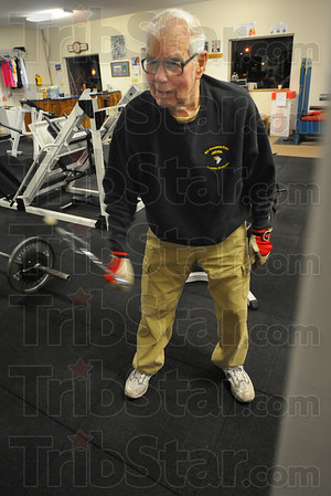 Tribune-Star/Jim Avelis<br /> Loosening up: Granville Lowe uses light weights on pulleys to loosen up as he starts his 5-day a week fitness routine.