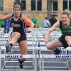 Tribune-Star/Jim Avelis<br /> Fastest: Viking hurdler Britt Solomon, right, won the girls' 100 meter hurdles, just edging out teammate Janelle Lucas, not pictured, and Tasia Brewer, left.