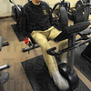 Tribune-Star/Jim Avelis<br /> Rolling along: Granville Lowe does his aerobic exercise on a stationary bike. He stays fully clothed due to the medications he takes that leave him feeling chilled otherwise.