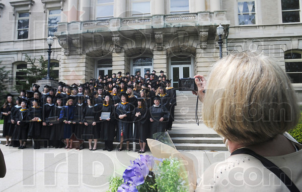 Tribune-Star/Rachel Keyes<br /> Proud mom: Proud mother Tina Putnam scans the group of graduates with her  camera looking for her daughter Victoria Putnam who Graduated with her Masters of Arts from St. Mary of the Woods College.