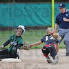 Tribune-Star/Rachel Keyes<br /> Out: West Vigo's Ciara McClain slides into second a hair late as Terre Haute South's Kelsey Marlow tags her out in the Big Four Classic Saturday.
