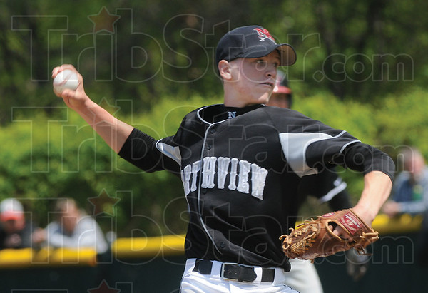 Tribune-Star/Rachel Keyes<br /> Strike: Northview's pitcher Craig Peters prepares what he hopes to be a strike in action Saturday against Terre Haute South.
