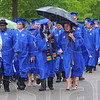 Tribune-Star/Jim Avelis<br /> Soggy start: Sttudents and faculty walk to Hulman Center is a light drizzle Saturday for their Commencement exercises