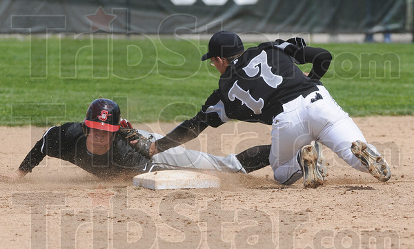 Tribune-Star/Rachel Keyes<br /> Sliding in: Terre Haute South's Jacob Johnson (left) is nearly tagged out by Northview's TJ Decker (right) in action Saturday.