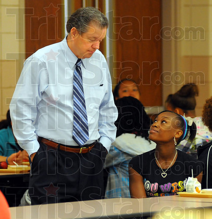 Tribune-Star/Jim Avelis<br /> Familiar faces: DeZhane Carter talks with Principal Mark Miller during lunch Wednesday.