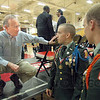 Military time: Governor Mitch Daniels takes time to speak with two JROTC Cadets after Wednesday's presentation of the Mr. Science Award to South student Joseph Botros.