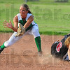 Tribune-Star/Jim Avelis<br /> A little late: Thunderbird shortstop Megan Stone takes a throw too late to tag Knight baserunner Samantha Montague.