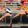 Tribune-Star/Jim Avelis<br /> Time to smile: Northview hurdler Annie Smiley, left, won the 100 meter hurdles in WIC competition Wednesday evening on the Knights' track. Placing 2nd was Sasha Robinson from Brown County.