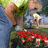 Budding: Ruth Wallace (L) and Carolyne Holcomb work planting flowers at the entrance of the Vigo County Fairgrounds.