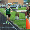 Tribune-Star/Jim Avelis<br /> Edged at the line: West Vigos' Andrew Kump, right, is just beaten at the finish line by Edgewoods' Cole Reinhold while Kumps' teammates watch.