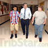 Tribune-Star/Jim Avelis<br /> Among the best: Retiring principal Mark Miller walks the halls of Sarah Scott Middle School with students C.J. Brown and Austin Lyttle.