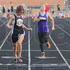 Tribune-Star/Jim Avelis<br /> Knight time: Northview sprinter Leanna Knight, in lane 3, placed second in the 100 meter dash, just beaten by Mustang Olivia Ashba in lane 5.